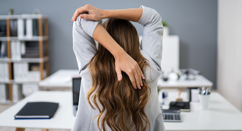 stretching at your desk - Three practices to help prevent burnout